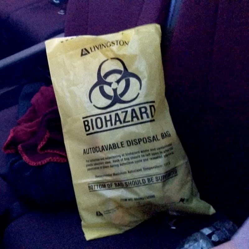 A yellow bag with a biohazard label